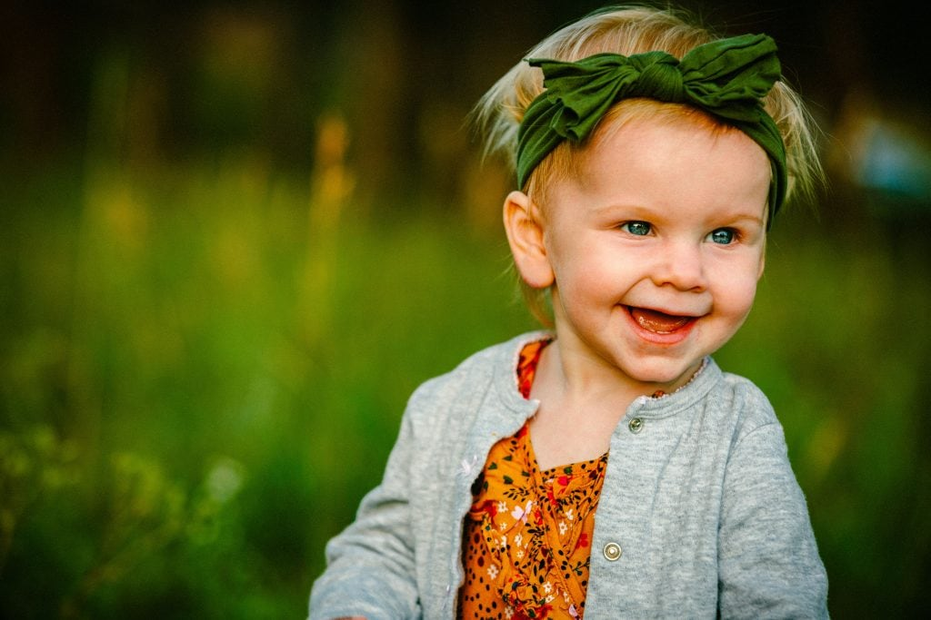 cute girl in pretty light with grass background