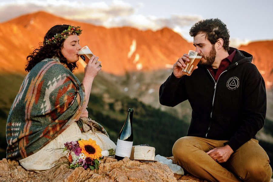 a couple enjoys a beer together after eloping on Loveland Pass