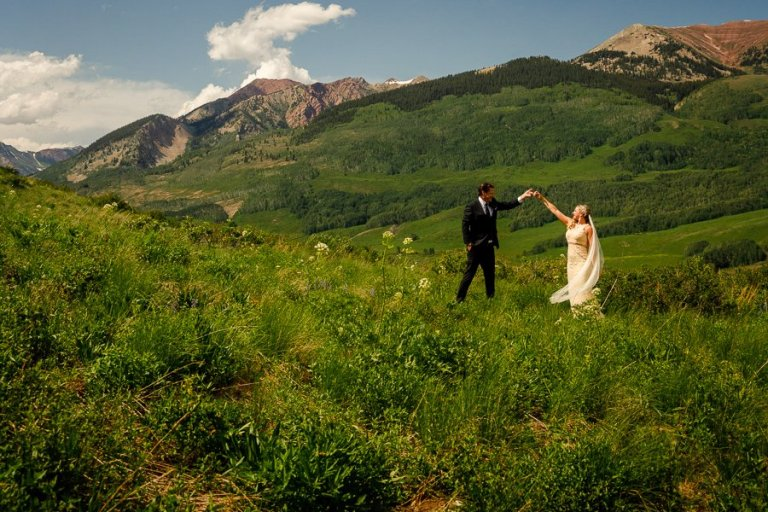 a couple dancing in the mountains in crested butte