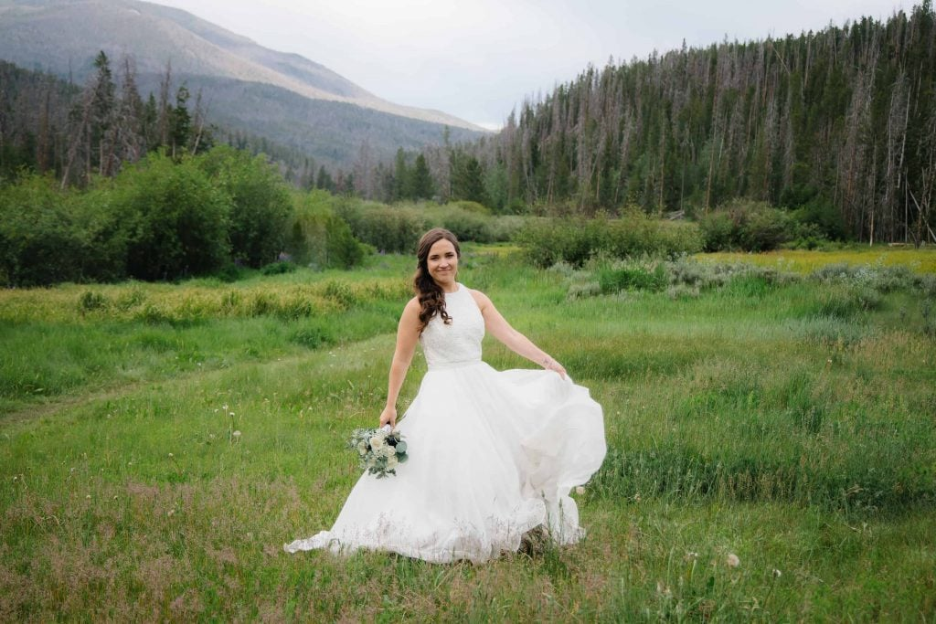 bride spins in dress after ceremony