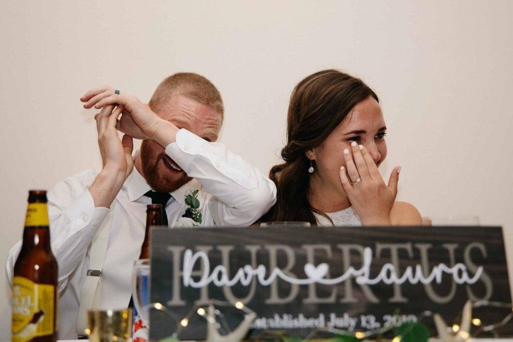 bride and groom cry during toasts