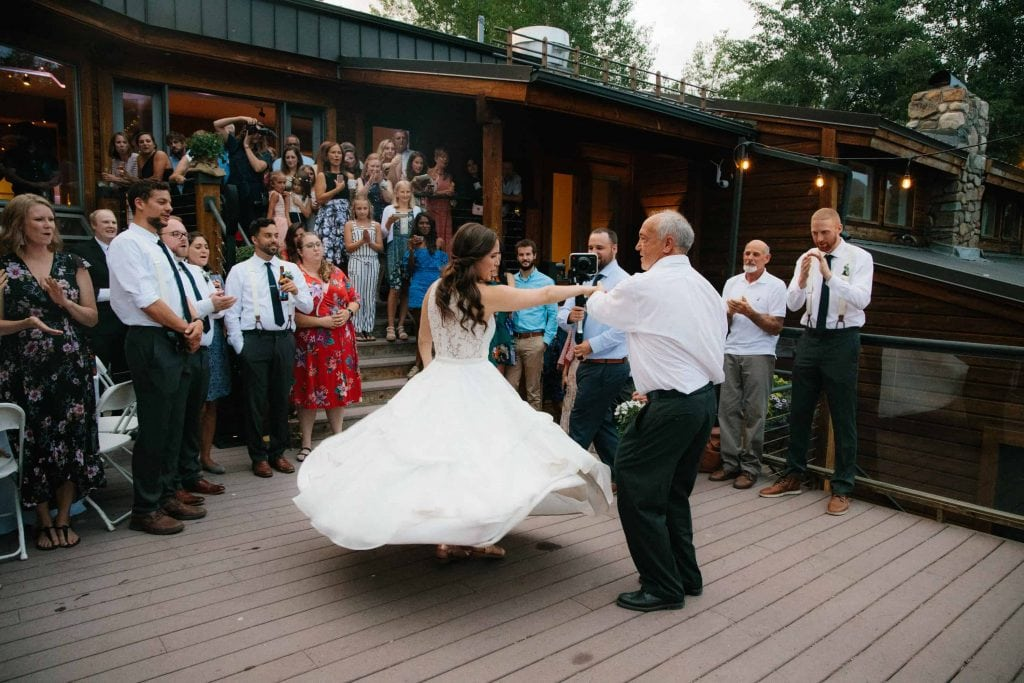 bride spins with wedding dress her mother made