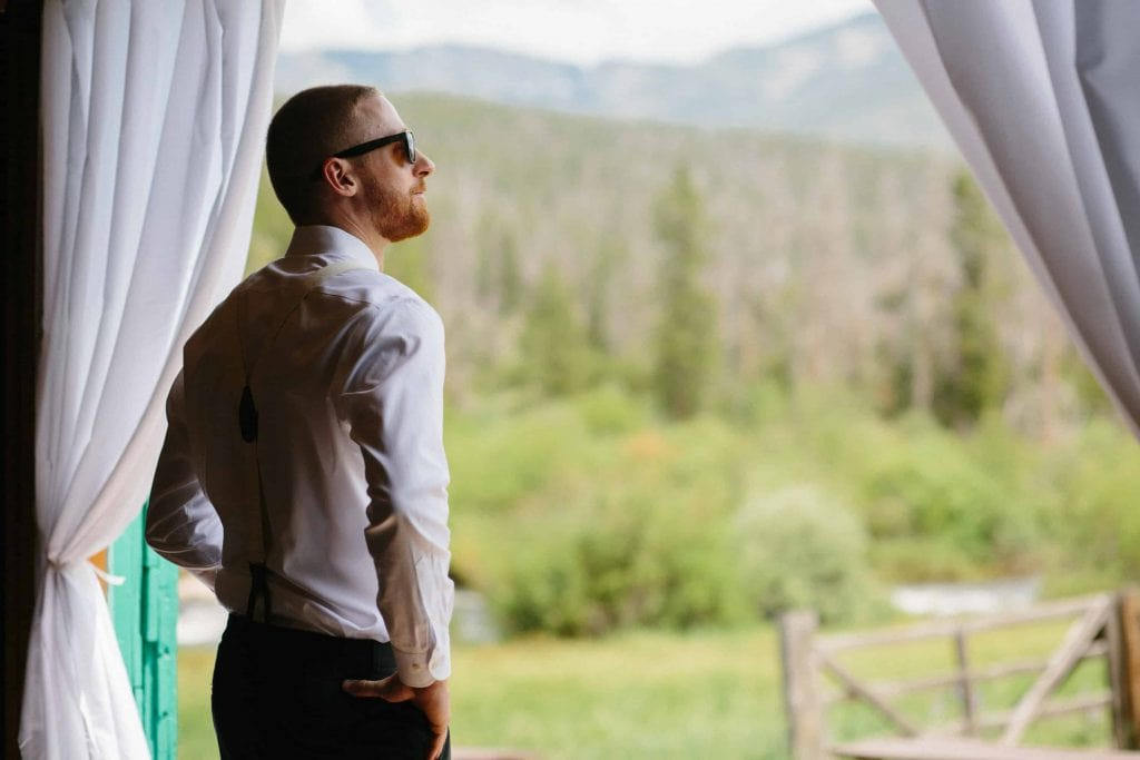 groom looks off into distance before ceremony