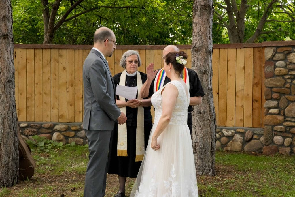 bride and groom are married by groom's parents