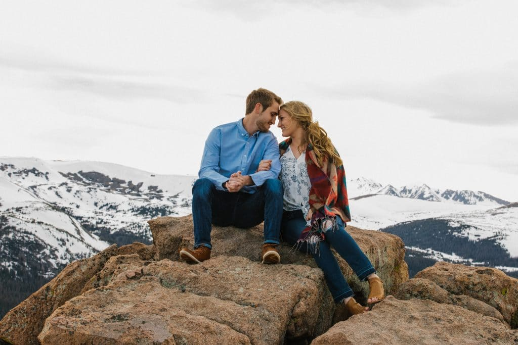 couple on a rock in rocky mountain national park