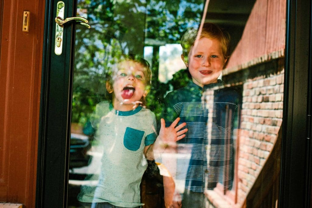 boys in the window with tongues out