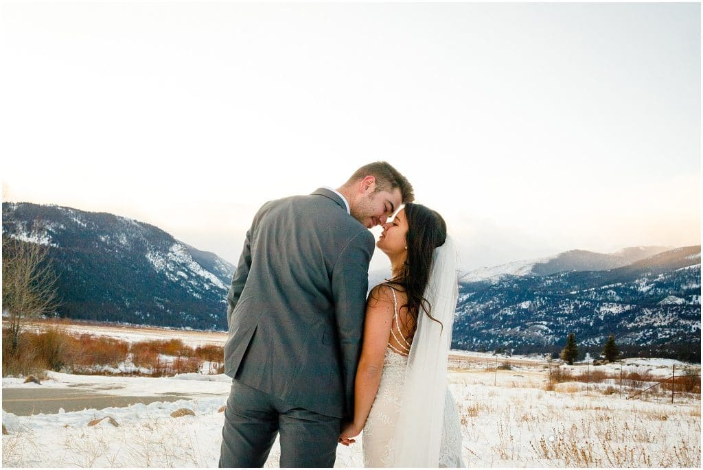 elopement in engaged couple look at each other during sunset in engagement session in look at the camera in Rocky Mountain National Park