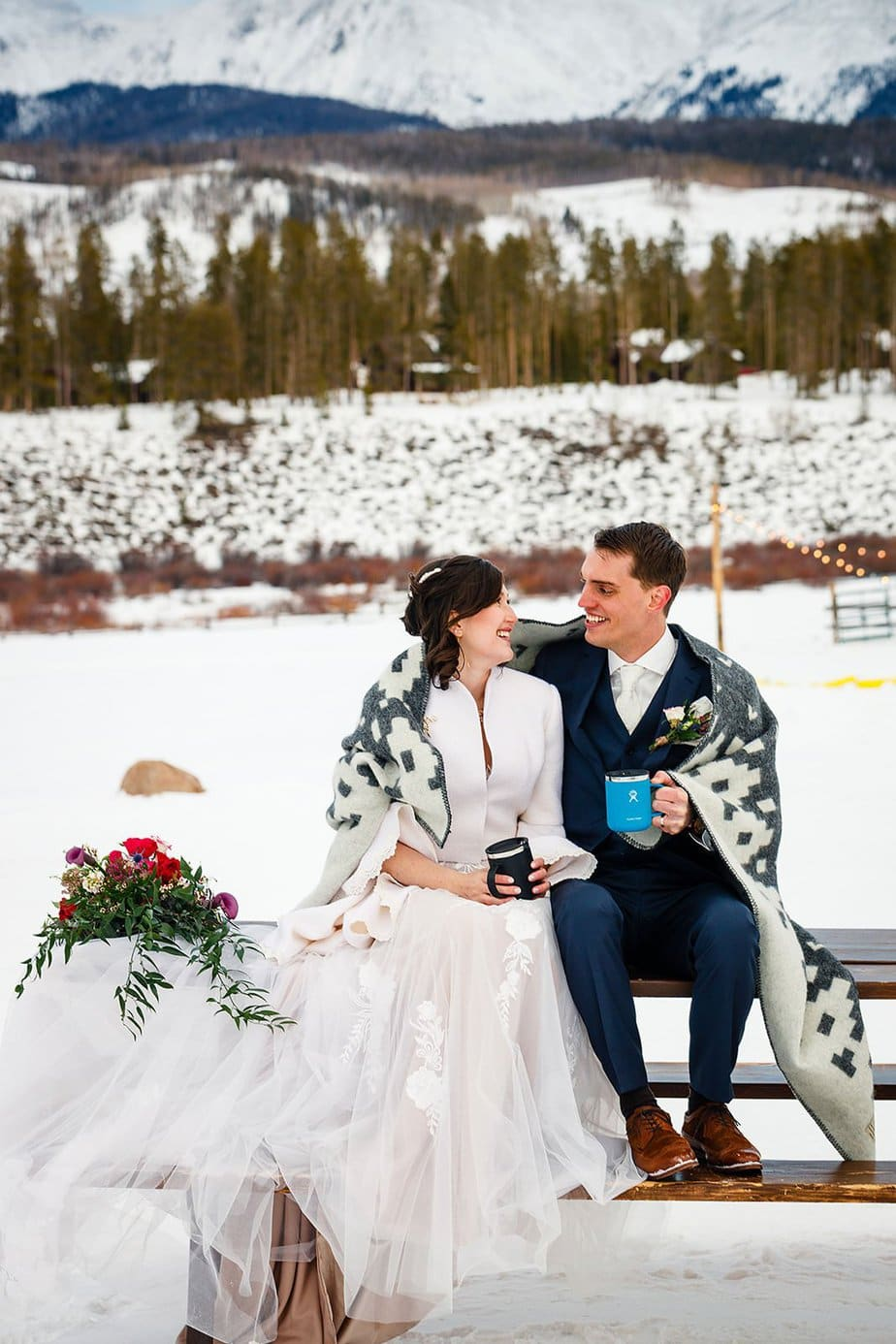 a couple drink hot chocolate after their elopement at devil's thumb ranch